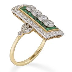 An Edwardian emerald and diamond plaque ring - Bentley & Skinner