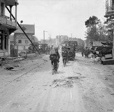 Vehicles and infantry on bicycles of British Division in La Brèche d'Hermanville, as they move inland from Sword Beach, 6 June A Churchill AVRE can be seen on the right. Churchill, D Day Ww2, Photos Du, Stock Photos, D Day Normandy, Normandy Invasion, Canadian Soldiers, Royal Engineers, Army Infantry