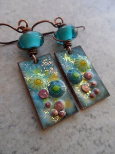 Gorgeous enameled copper charms, expertly handcrafted by Tina Piraino, are perfectly matched with beautiful lampwork beads, handcrafted by Juli