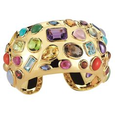 1950s Seaman Schepps Multicolored Stone Gold Cuff Bracelet | From a unique collection of vintage cuff bracelets at https://www.1stdibs.com/jewelry/bracelets/cuff-bracelets/