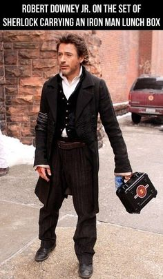 """Robert Downey Jr on the set of """"Sherlock Holmes"""" carrying an Iron Man lunchbox. What is it about this man? He's funny and hot! Sherlock Holmes, Watch Sherlock, Robert Downey Jr., Iron Man, Plus Tv, Hilarious, Funny Memes, Funny Quotes, Funny Ads"""