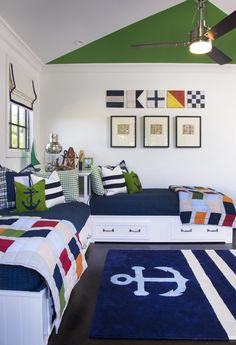 fun paint treatment for kids' room; green, white, navy blue, nautical flags, trundle beds