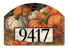 "Pumpkin Garden Address Sign by MagnetWorks. $15.80. Magnetic address sign measures 14"" x 10"".. Or display as hanging address sign using our Ornamental Address Post.. Address plaques snap into place onto our Yard Stake.. Vinyl coated for long lasting beauty.. Includes 2 sets of easy-to-apply self-adhesive address numbers.. Plant a Yard DeSIGNs stake in your yard or garden then decorate it seasonally with interchangeable magnetic faces! Interchangeable artwork created by Ameri..."