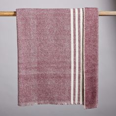 """HERITAGE WOOL THROW--Here's one to plan on passing to the next generation. Sheep pastured in the cool mists of Canada contribute their fine, dense wool to this cozy throw, woven with contrasting stripes and finished with whipstitching. Canada. 48""""W x 60""""L."""