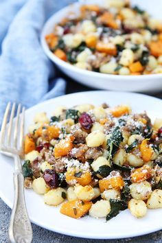 Butternut Squash, Sausage, and Kale Gnocchi Recipe on twopeasandtheirpod.com Gnocchi with roasted butternut squash, sausage, kale, dried cranberries, rosemary, and Parmigiano Reggiano cheese. The perfect fall meal!