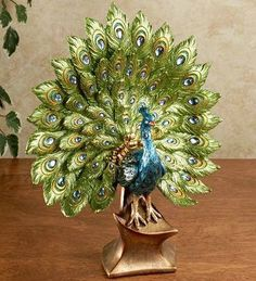 Balinese Peacock $99.95		Peacock Table Sculpture $42.99 www.allthingspeacock.com - Peacock Figurines (1)