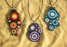 Vasariah Creations. Is this really paper, or a polymer clay pendant that looks like quilling.