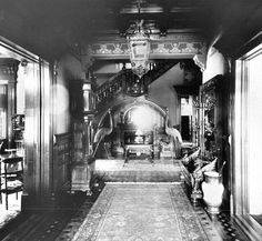 Entrance hall. Chester Wickwire House, Cortland, NY. Photograph, 1890-1900. The 1890 House Museum &Center for Victorian Art, Cortland, NY. Located under staircase in back of hall is paneled alcove w built-in benches flanking a fireplace-the inglenook which appeared in American homes in 1870s &became common to entrance halls in fashionable houses. This cozy, intimate space softened the formality of the hall as a waiting area for visitors, made it conducive to use as a living room.