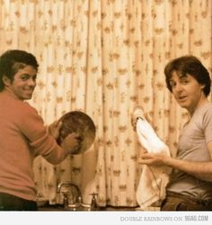 Paul McCartney and Michael Jackson doing dishes.