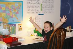 He Loves His Classroom ~ You will too...check out the solar system wall !!