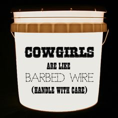 This bucket light features the words Cowgirls Are Like Barbed Wire Handle With Care.