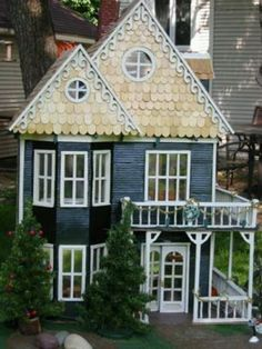 Blue dollhouse with porches on both levels.