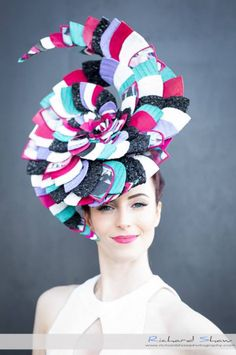 Annie Johnson (@_anniejohnson) wearing a gorgeous Christie Millinery (@christiemillinery) spiral succulent headpiece. Each of the 200+ petals are unique and colour sequenced made of a blend of Italian and Swiss braid, digital print Italian material and thermoplastic.   http://www.christiemillinerydesigns.com