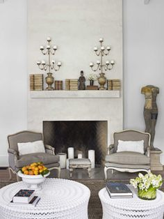 A clean,simple Fireplace -the fireplace is faced in plaster mixed with marble dust,to add depth and texture,Antique Candelabra have an aged finish so easy on the eye by Dan Corbin >>>ew4/5-12
