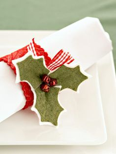 Make this simple holly napkin ring with felt and jingle bells to bring cheer to the Christmas table.