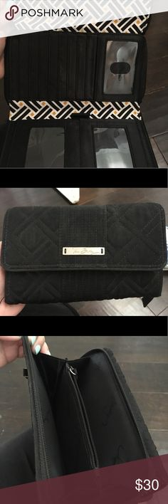 Vera Bradley Wallet Barely used, large black quilted Vera Bradley wallet. They do not make this style anymore. Lots of space for cards, cash, and even a checkbook. Vera Bradley Bags Wallets