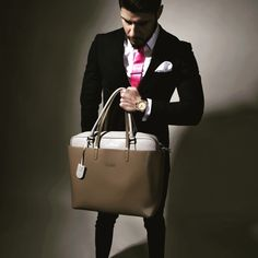 A well tailored suited man  with the right accessory  is an ultimate seduction communicator (Pierre Garroudi luxury handbags)
