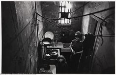 Hungry: A woman and her child look up from the kitchen of a council-owned property in a slum in Balsall Heath, Birmingham in November 1969. Above them a makeshift washing line is tied to the exposed water pipes attached to the peeling, damp-ridden walls in the dank room  Read more: http://www.dailymail.co.uk/news/article-2776842/Shocking-photos-capture-real-squalor-Britain-s-slums-poverty-meant-afford-Playstation.html#ixzz3FMEOCluM  Follow us: @MailOnline on Twitter | DailyMail on Facebook