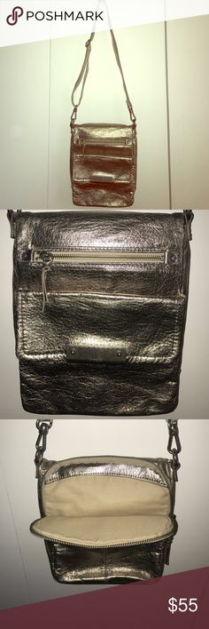 The Sak media crossbody The Sak media crossbody in metallic silver with multiple zippered outside pockets and flap outside pocket. Inside has place holders for ID and cards and zippered pocket and cellphone pocket with adjustable strap The Sak Bags Crossbody Bags