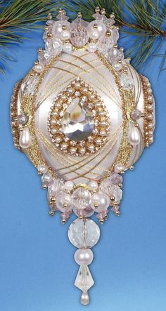 Kits to embellish include wrapped satin ornament, rhinestone strands, beads, pearls, acrylic crystals, thread, pins and trim.