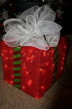 How to Make a Lighted Christmas Box Decoration. For a sturdier box, use wooden slats cut to size, then use staple small chicken wire and continue as posted.