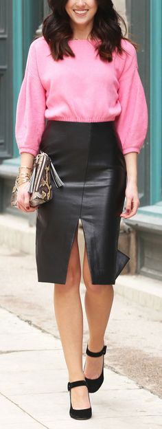 Pop of pink for Valentine's Day in this bubblegum sweater under $100! Matching with slit leather skirt, velvet pumps and snake skin clutch. Affordable and chic date night outfit! By fashion blog Marie's Bazaar