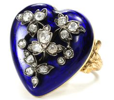 """The decades from about 1840 to 1860 could be termed the Victorian """"sentimental years"""" as this was the time frame during which much jewelry symbolic of love, friendship and loss was given and received. The late 18th century tradition of a ring with a cobalt or royal blue field upon which a monogram or cypher in applied diamonds is the ancestor of this antique love ring."""