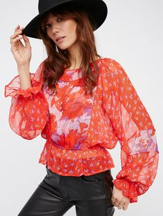 Into The Wilderness Blouse | Pretty sheer top featuring a mixed soft floral print. Elastic at the waist and sleeve cuffs created ruffled edges. Large back keyhole cutout with simple button closures.