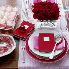 Paint the town red! Make a lasting impression with a bold pairing of crimson and pink. 3 Ways to Get the Color Scheme: Create a dramatic floral arrangement with just one type of crimson bloom. Here we chose roses. Top a clear tray with pink votive candles for an easy and impactful centerpiece. Layer red serving pieces with pink textiles for an unforgettable tabletop.
