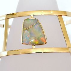 This is a custom design from the past - such a striking opal deserved a bold design