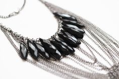 """The """"Anuket"""" from our Black Collection. Chains and beads, the perfect combination"""