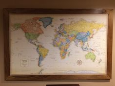 My husband and I completed this as a birthday present for our youngest daughter.   She wanted something to pin to detail where she has traveled to.  It involved a large Rand McNally vintage map (Amazon), foam board, 3m multi purpose spray adhesive, 1x3 poplar (for frame), and for the back a piece of paneling type material from Lowes.   Corners are biscuit joined.   A beautiful piece.