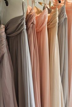 Bridesmaids dresses in different shades of one color family.