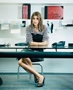 Carine Roitfeld  at her desk as Vogue Paris Editor-in-Chief.