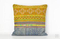 One of a kind bohemian decorative pillow cover made with vintage Hmong textiles, hand-printed in batik technique and indigo dyed.  [ Front ] Vintage Hmong batik piece hand-printed on cotton with traditional patterns and indigo dyed, attached with large piece of extensive colorful cross-stitch embroidery work with applique lines. Formerly a Hmong womens skirt.  [Reverse ] New indigo 100% handwoven cotton fabric from traditional weavers village in Northern Thailand  [ Approx. Measurement ] 16…