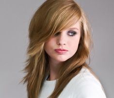 layered and choppy cut with side bangs