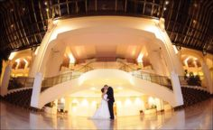 Stunning wedding photo taken in the Chateau Elan Winery & Resort atrium. Learn more about North Georgia's premier wedding and event venue at www.chateauelan.com