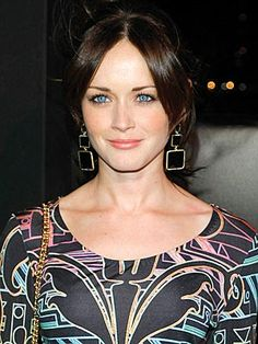 I love blue eyes and dark hair...maybe someday I will get the nerve up to go dark!