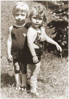 Portrait of Rene and Renate Guttmann standing outside. Mengele twins.  In the fall of 1947 Renate was chosen by the chairman of Rescue Children, Inc., Herbert Tenzer, to travel to the United States with another Jewish orphan, Charles Karo, to raise money for Jewish children's homes in France. The children became the focus of considerable media attention and appeared on the cover of Life magazine. The twins were separated in the wars aftermath, but eventually reunited and adopted together.