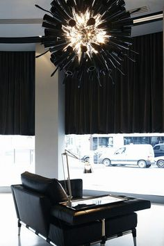 Design pendant lamp in blown glass and hand-made. It looks like a big black cloud over us.....