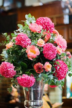 vibrant pink and peach floral displays, see more at http://www.weddingchicks.com/2013/08/27/modern-london-wedding/