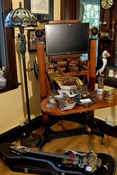 Geek Gives New England Home an Extreme Steampunk Makeover Steampunk Guitar, Steampunk House, Steampunk Gears, Steampunk Design, Console, Steampunk Gadgets, Antique Typewriter, Computer Workstation, Antique Cameras