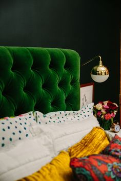 Rich bedroom colors and patterns. Emerald green, gold accents, dark dramatic wall