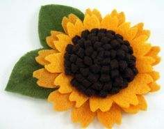 What about in shades of white with a brooch for the center? Felt Sunflower Pattern Tutorial ... No by SundayGirlDesigns, $6.00