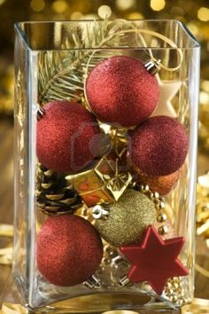 Fill a vase with ornaments for Christmas