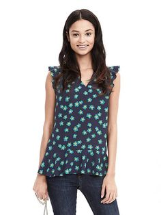 I just bought this shirt and I love it. I'm not a ruffles girl but they are subtle here - Floral V-Neck Ruffle Tank   Banana Republic