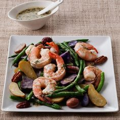 String Bean and Fingerling Potato Salad With Shrimp:  Shrimp are a low-cal, low-fat source of lean protein. While the potatoes and beans are cooking, make the tangy, low-cal vinaigrette. | Health.com