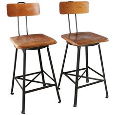 Pair of Vintage Industrial Wood and Metal Bar Stools | From a unique collection of antique and modern stools at https://www.1stdibs.com/furniture/seating/stools/