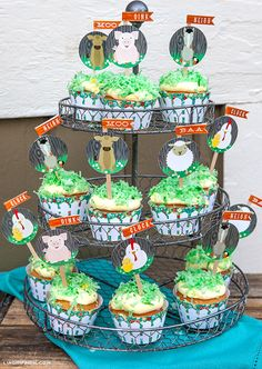 Yee Haw!  Farm Party by Lisa Frank and Lia Griffith: cupcakes with homemade green coconut grass // printable wrappers, toppers and flags by Lia Griffith