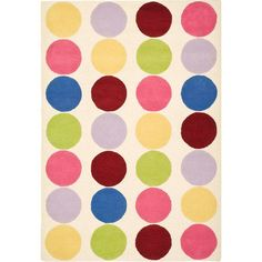 Add a pop of pattern to your little one's room or play area with this hand-tufted wool rug, showcasing a multicolored polka-dot pattern.   ...